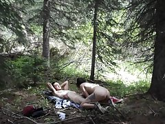Naughty couple is fond of hiking and fucking doggy right close to the forest