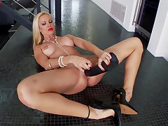 Sultry MILF Sandy uses a huge act black dick in the brush clam