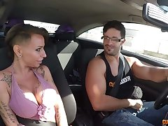 Broad in the beam tittied hooker Gina Snake is picked up and fucked in the motor