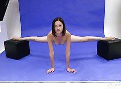 Slender Russian teen Galina Markova does the splits and shows bald pussy